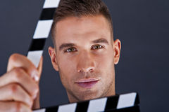 Man with movie clap Stock Images