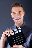 Man with movie clap Royalty Free Stock Image