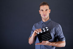Man with movie clap Stock Image