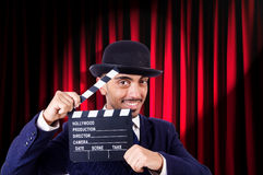 Man with movie clapper Royalty Free Stock Photos