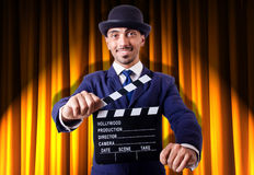 Man with movie clapper Stock Photos