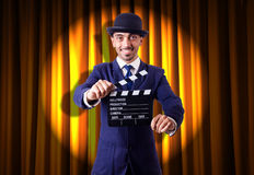 Man with movie clapper Royalty Free Stock Images