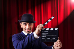 Man with movie clapper Stock Image
