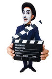 Man with movie clapper Stock Images