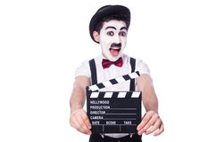 Man with movie clapper Stock Photography