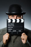 Man with movie clapperboard. And hat Royalty Free Stock Image