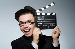 Man with movie clapperboard Stock Photos