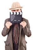 Man with movie clapperboard Stock Image