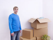 Man with moving boxes Royalty Free Stock Image