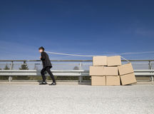 Man with Moving Boxes Royalty Free Stock Images