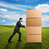 Man moving boxes Stock Image