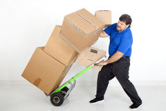 Man moving boxs with a hand truck. Man moving boxes with a hand truck or dolly Royalty Free Stock Images