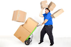 Man moving boxs with a hand truck. Royalty Free Stock Images
