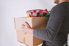 Man on moving carrying cardboard box stock images