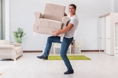 The man moving furniture at home Royalty Free Stock Image
