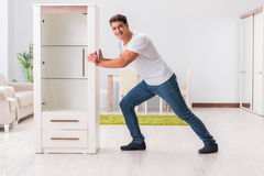 The man moving furniture at home Royalty Free Stock Photography
