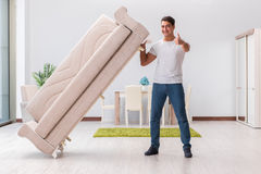 The man moving furniture at home Stock Photos
