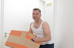 Man moving home carrying cardboard cartons Royalty Free Stock Photography