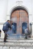 Man moving incense at the Church of Santo Tomas at Chichicastena Royalty Free Stock Photo