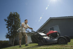 Man Moving Lawn Royalty Free Stock Images