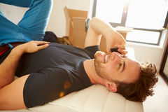 Man Moving Into New Home Talking On Mobile Phone Stock Photo