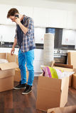 Man Moving Into New Home Talking On Mobile Phone Stock Image