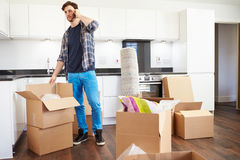 Man Moving Into New Home Talking On Mobile Phone Stock Photography