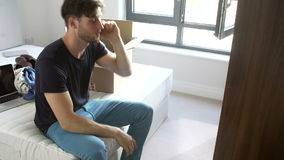 Man Moving Into New Home Talking On Mobile Phone stock footage
