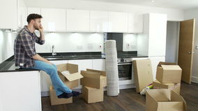 Man Moving Into New Home Talking On Mobile Phone stock video footage