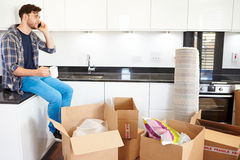 Man Moving Into New Home Talking On Mobile Phone Royalty Free Stock Images