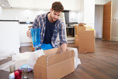 Man Moving Into New Home And Unpacking Boxes Stock Image