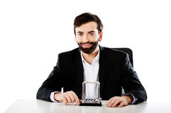 Man moving newton balls in office. Businessman moving newton balls in office Royalty Free Stock Photo