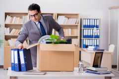The man moving office with box and his belongings. Man moving office with box and his belongings Stock Images