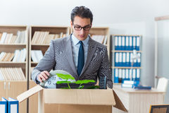 The man moving office with box and his belongings Stock Photo