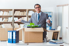 The man moving office with box and his belongings Royalty Free Stock Photos