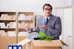 The man moving office with box and his belongings Stock Photos