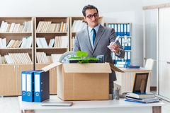 The man moving office with box and his belongings Stock Images