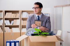 The man moving office with box and his belongings Stock Image