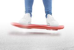 Man moving on red hover board scooter isolated. Royalty Free Stock Image