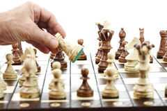 Man moving rook on chessboard Royalty Free Stock Photography