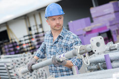 Man moving scaffold pole. Man moving a scaffold pole Royalty Free Stock Photos