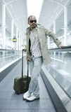 Man on moving walkway Stock Image