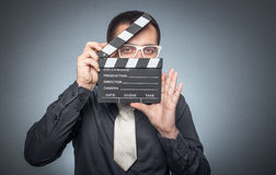 Man with movir clapper board Royalty Free Stock Photos