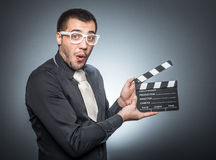 Man with movir clapper board Royalty Free Stock Photo