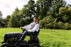 Man and mower. Royalty Free Stock Images