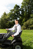 Man and mower. Stock Photos