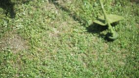 A man mowing grass lawn mower stock video footage