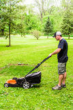 Man Mowing Grass Side View stock images