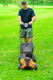 Man Mowing Grass Smiling stock photography