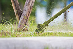 A man mowing the grass Royalty Free Stock Images